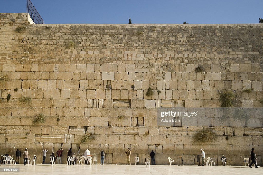 A large group of men praying at the Wailing Wall