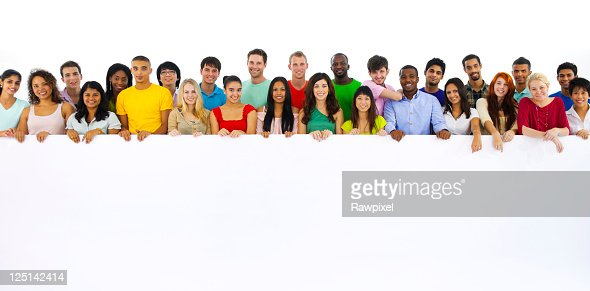 Large group of multi ethnic youths holding a placard : Stock Photo