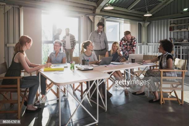 Large group of multi-tasking entrepreneurs working in the office.