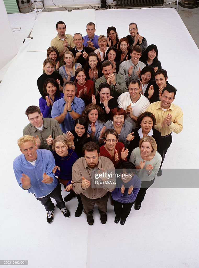 Large group of people applauding, posing in studio, portrait, elevated view : Stock Photo