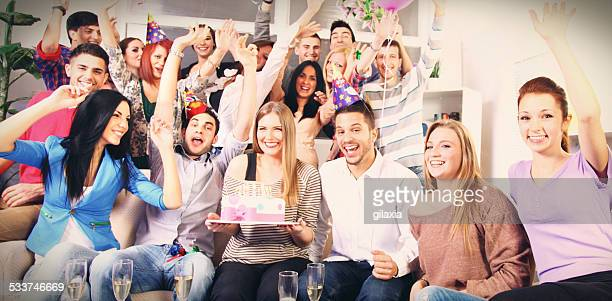 Large group of people at birthday party.