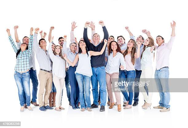 Large group of people celebrating with arms up