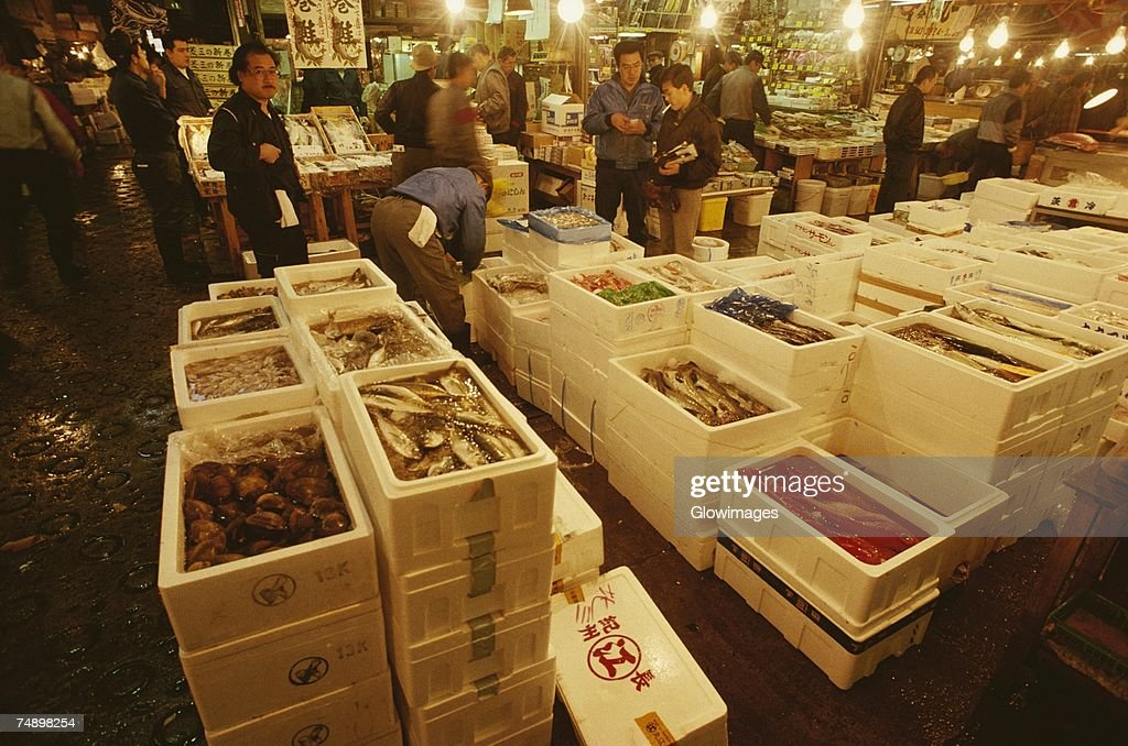 Large group of people in a fish market, Tsukiji Fish market, Tsukiji, Tokyo Prefecture, Japan