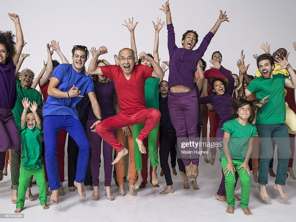 Large Group of people jumping happily in studio : Stock Photo