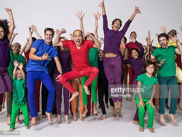 Large Group of people jumping happily in studio