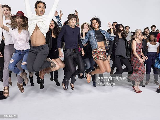 Large group of people jumping happily together
