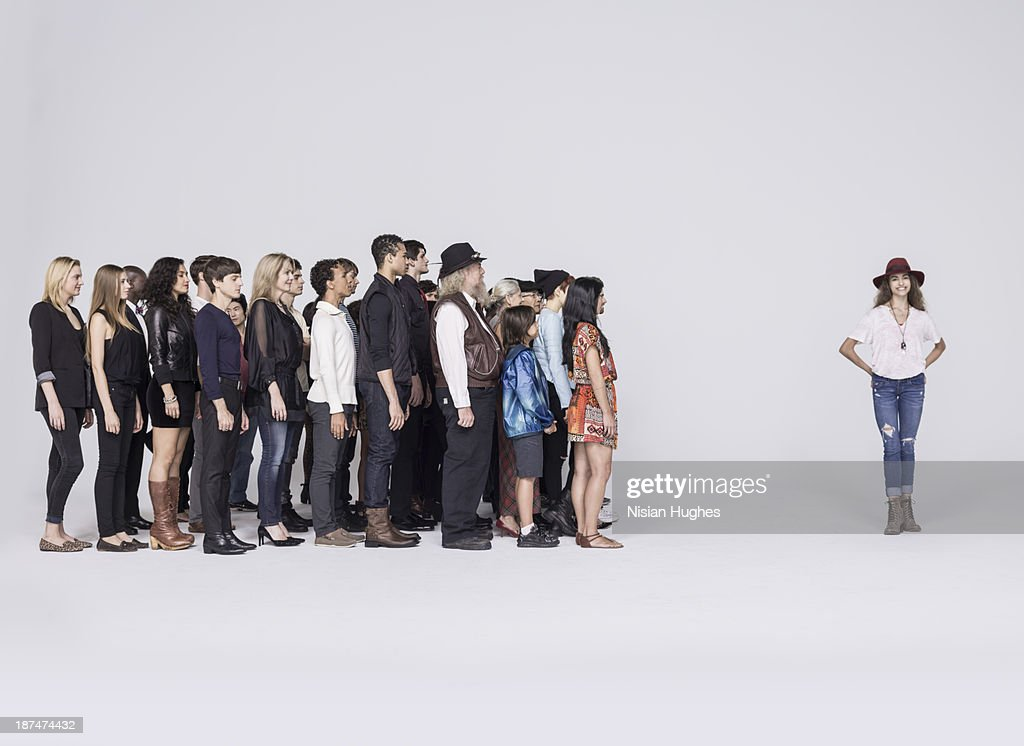 Large Group of people looking at woman
