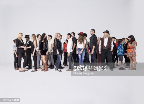 Large Group of people standing together talking