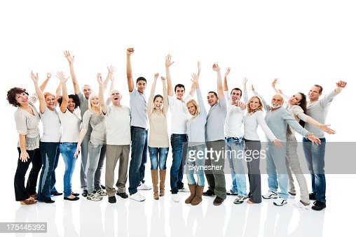 Large group of people standing together with raised arms.