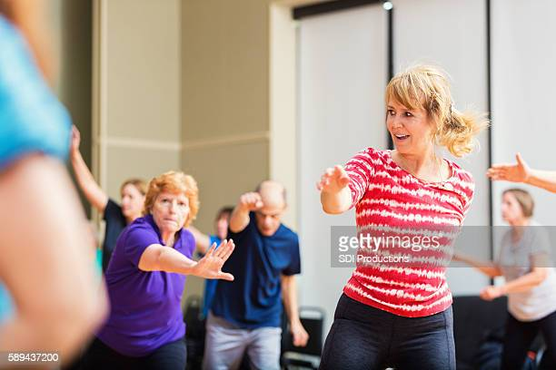 Large group of people taking dancing fitness class