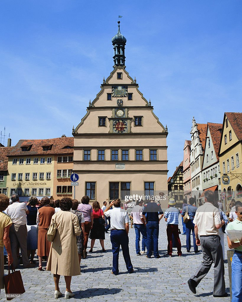 Large group of people watching clock tower in Rothenburg, Germany : Stock Photo