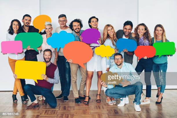 Large group of people with colorful speech bubbles