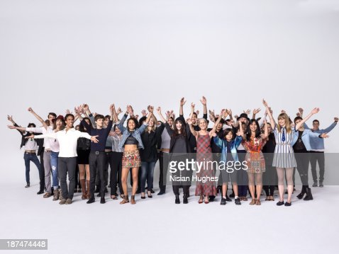 Large group of people with raised hands