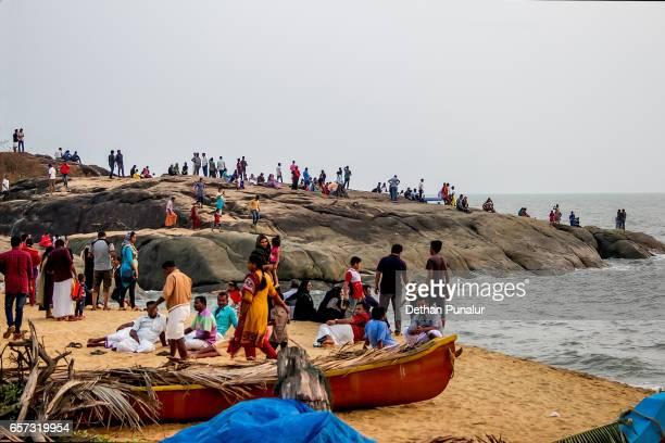 A large group of peoples entertaining an evening at Kappad Beach (Kozhikode), Kerala.