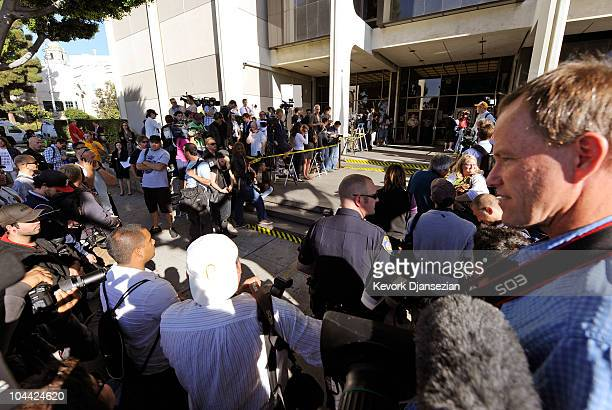 A large group of photographers and media wait for the departure of actress Lindsay Lohan after a mandatory court appearance before a judge at Beverly...