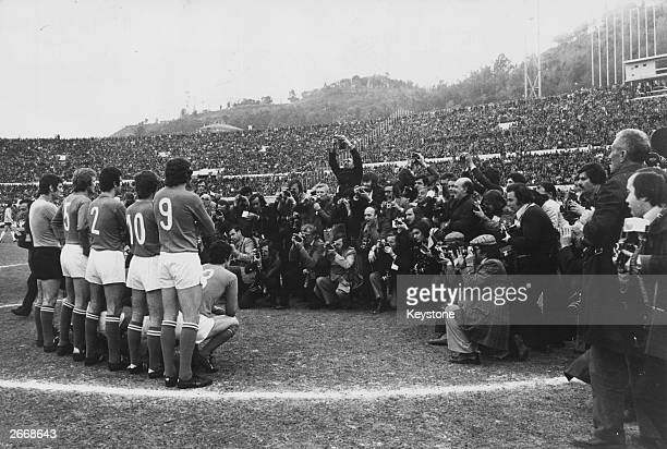 A large group of photographers photograph the Italian football team at the Olympic Stadium in Rome before they take on West Germany in the European...