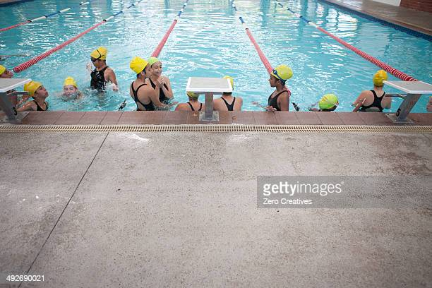 Large group of schoolgirls taking a break in swimming pool