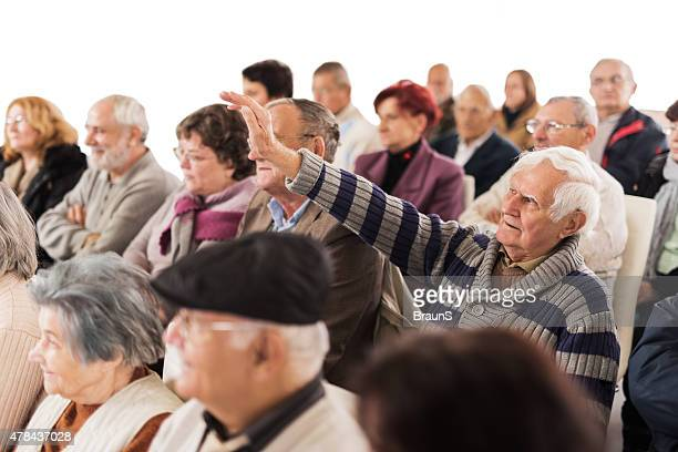 Large group of senior people attending a seminar.