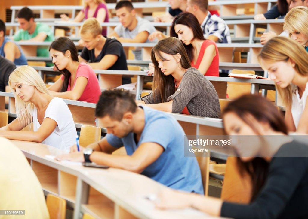 Large group of students writing. : Stock Photo