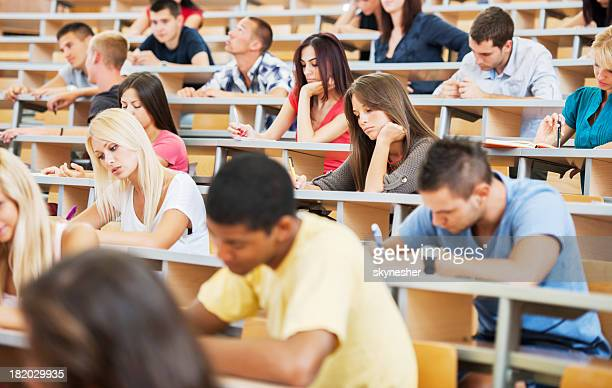Large group of students writing