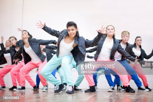 Large group of teenagers dancing in studio