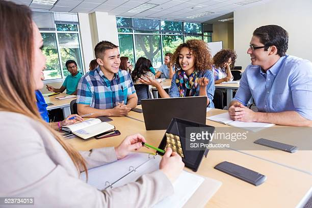 Large group of teens studying in group for college class