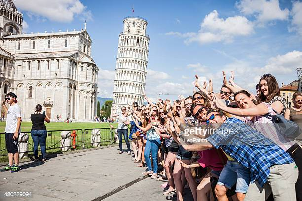 Large group of tourist having fun in Pisa