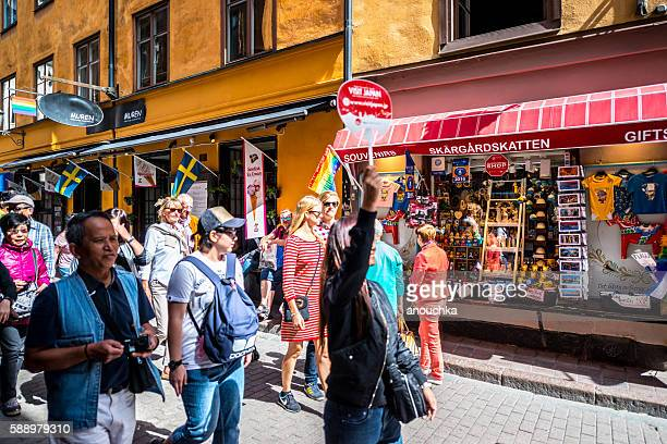 Large group of tourists in Gamla Stan, Stockholm, Sweden