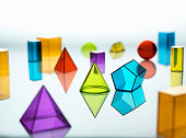 Large group of various multi colored geometric shapes
