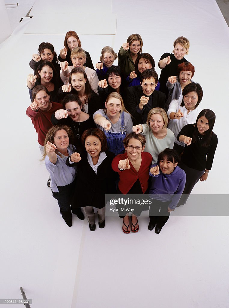 Large group of women, pointing at camera, posing in studio, portrait, elevated view : Stock Photo
