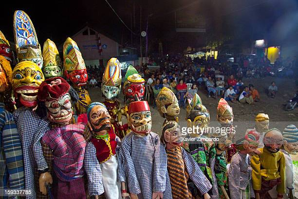 Large groups of puppets and spectators at a night performance of Wayang Goreng by the Master Dalang Ki Mursidin during a marriage ceremony on August...