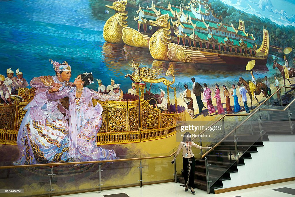 A large hand-painted mural decorates Yangon International airport on November 30, 2012 in downtown Yangon, Myanmar. Business opportunities are expanding in the Southeast Asian country as it emerges from financial isolation. Import restrictions have been eased resulting in many new cars seen on the streets.