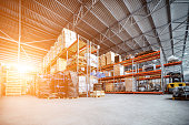 Large hangar warehouse industrial and logistics companies. Warehousing on the floor and called the high shelves. Toning the image.