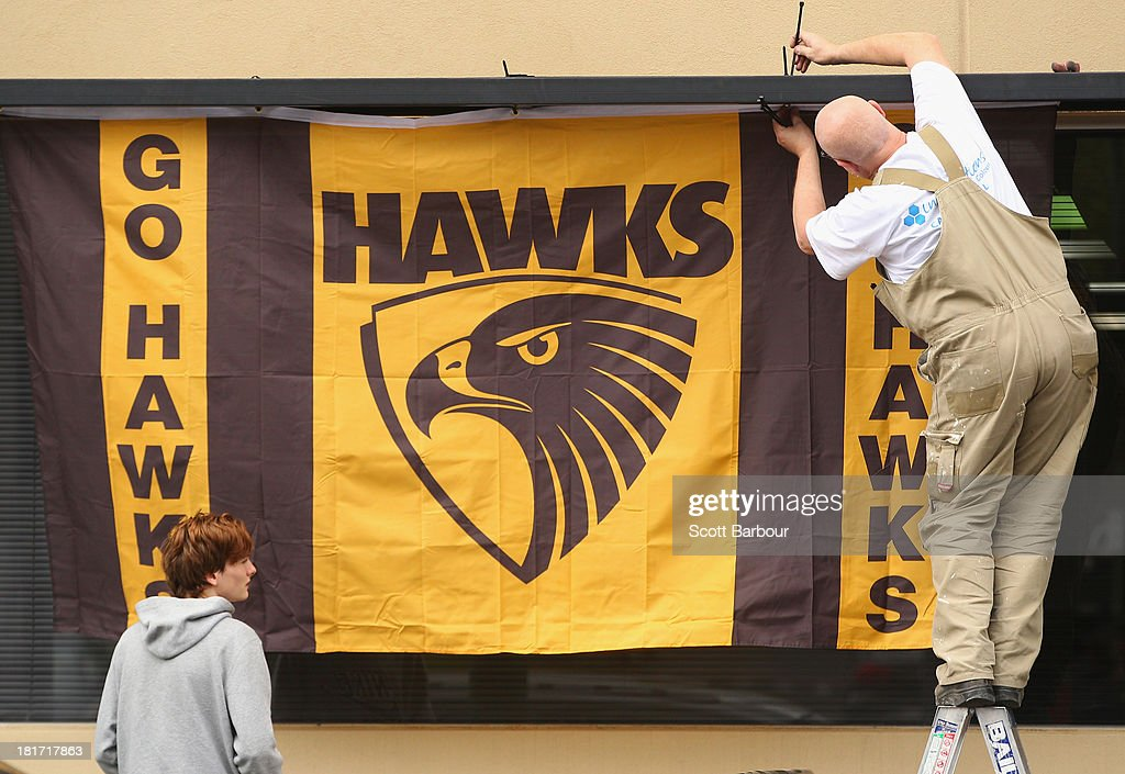 A large Hawthorn Hawks flag is hung from a window outside of a shop on Glenferrie Road in Hawthorn on September 24, 2013 in Melbourne, Australia. The Hawthorn Hawks play the Fremantle Dockers this Saturday in this year's 2013 AFL Grand Final.