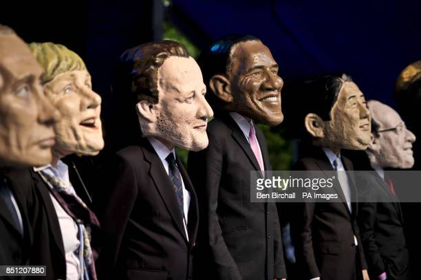 Large headed impersonators of the G8 politicians arrive onstage at Belfast Botanic Gardens where the Big IF Belfast concert is taking place ahead of...