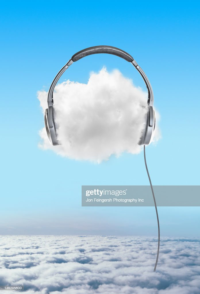 Large headphones on cloud in sky : Stock Photo