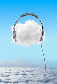 Large headphones on cloud in sky