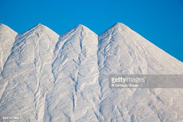 Large heaps of white salt
