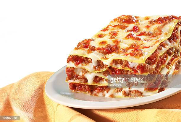 Large helping of lasagna on a white plate