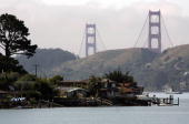 Large homes stand on the shores of the Richardson Bay near the Golden Gate Bridge May 17 2007 in Belvedere California The San Francisco Bay Area has...