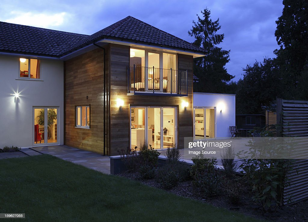 Large house illuminated in the evening : Stock Photo