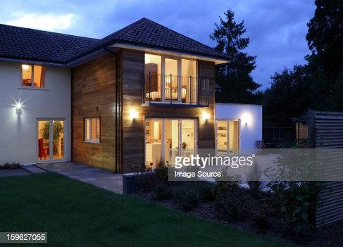 Large house illuminated in the evening : Stock Photo