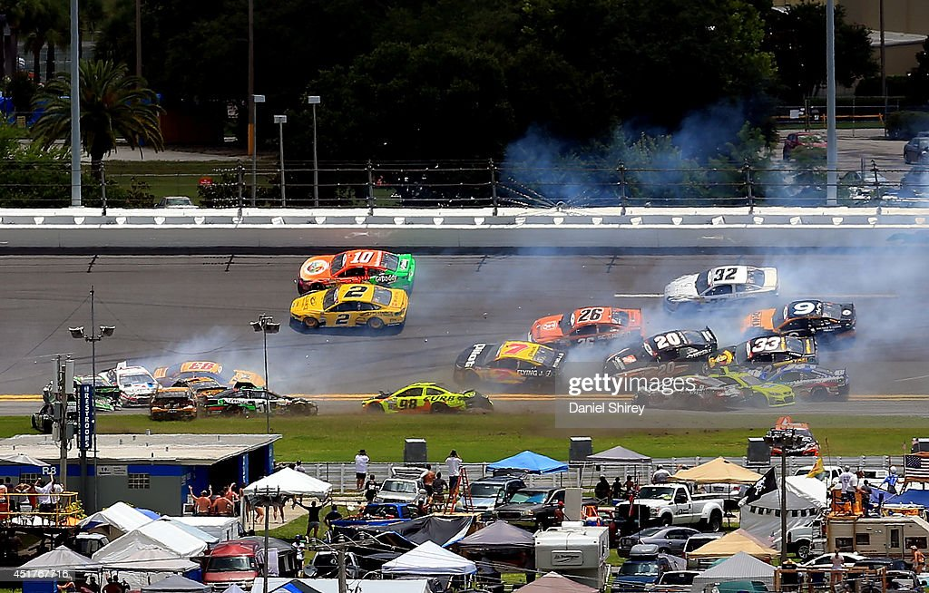 A large incident occurs in turn three during the NASCAR Sprint Cup Series Coke Zero 400 at Daytona International Speedway on July 6, 2014 in Daytona Beach, Florida.