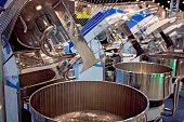 Large industrial dough mixing machine in bakery
