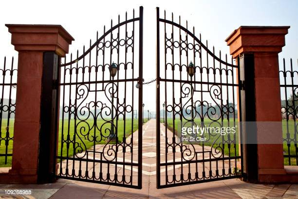 Large iron gates secured with padlock