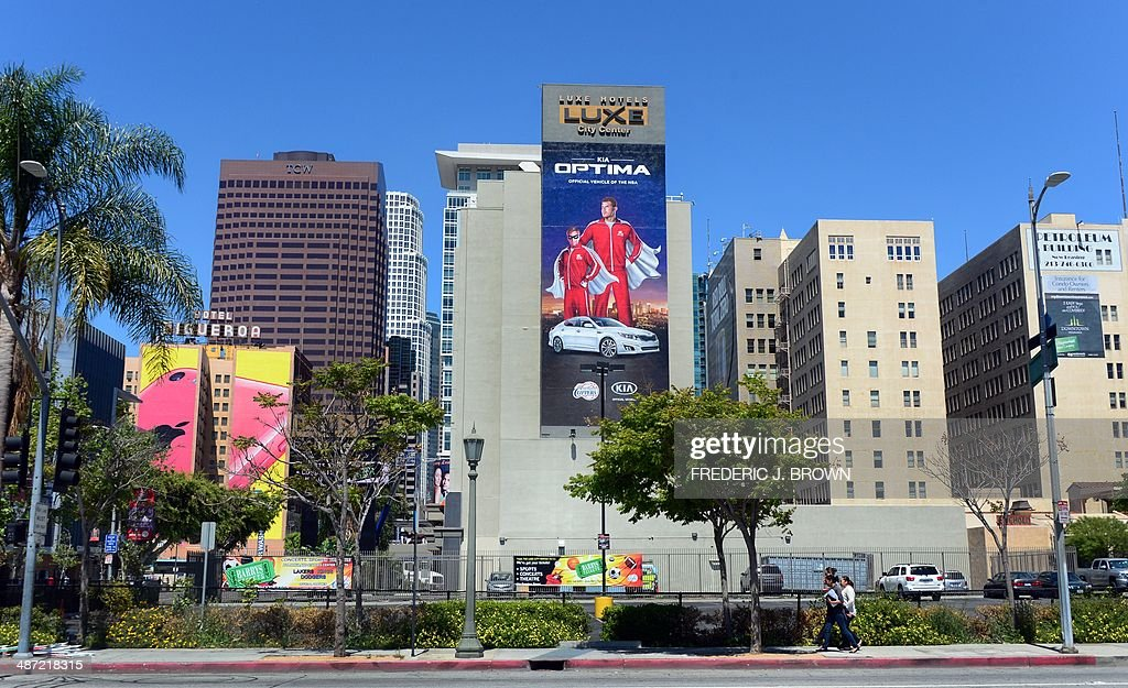 A large Kia Motors advertisement sponsoring the NBA's Los Angeles Clippers runs down the side of a highrise building across from Staples Center home...