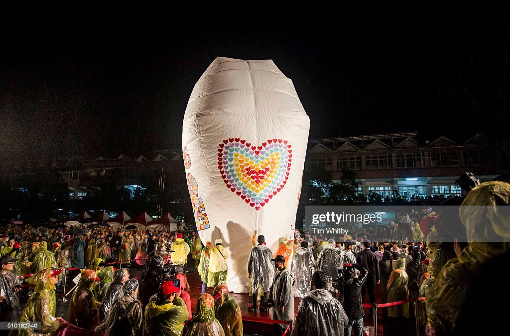 A large lantern is prepared for launch at the Pingxi Sky Lantern Festival on February 14, 2016 at the Pingxi Junior High School in Pingxi District, New Taipei City, Taiwan. The event is the second of three organised lantern releases and the theme for the launch is 'Two Hearts Together'. Participants were encouraged to 'leave their love in Pingxi' and draw hearts on their lanterns.