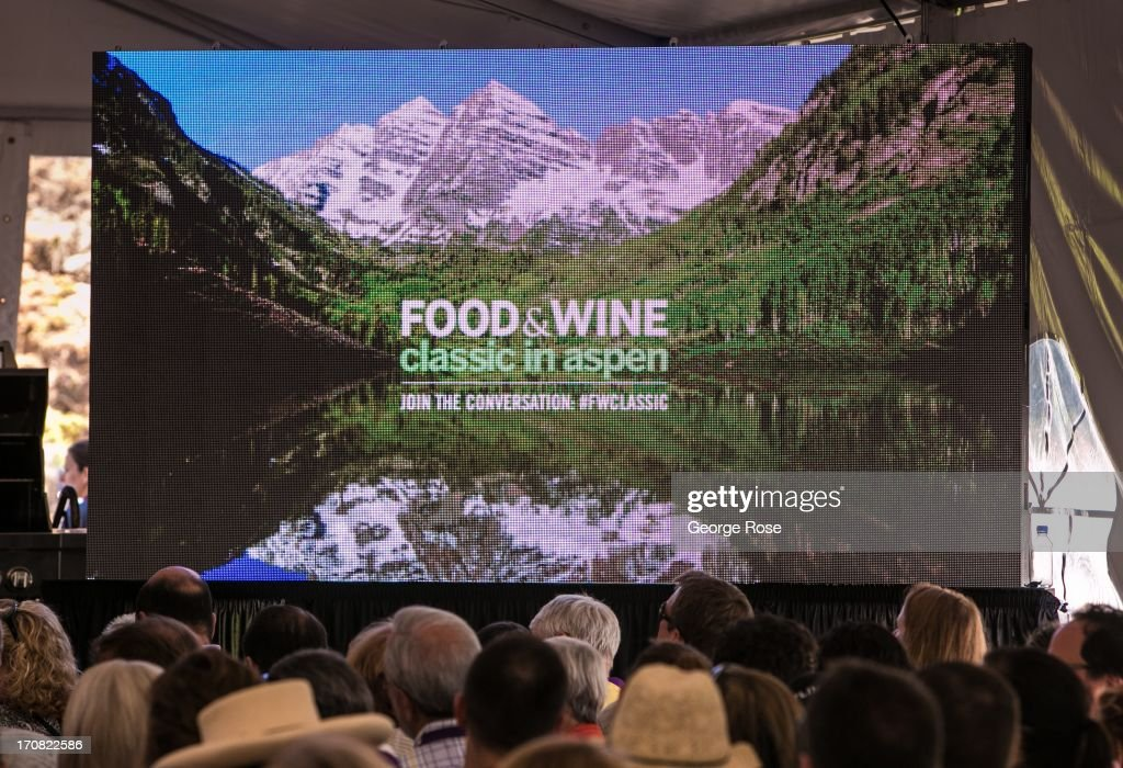 A large LED screen displays a picture of the Maroon Bells during a cooking demonstration on June 14 in Aspen Colorado The 31st Annual Food Wine...