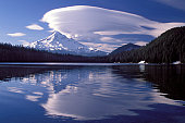 Large lenticular cloud hanging over Mt Hood reflected in Lost Lake in the Oregon Cascades