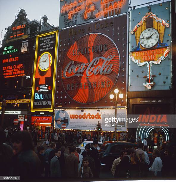 Large lighted billboard advertisements in Piccadilly Square in the heart of London England